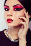 Fashion model portrait. Scarlet makeup. Black arrows. Stock Images