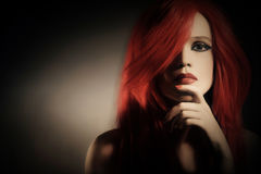Fashion model portrait. Woman portrait fashion model with red hair Stock Image