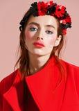 Fashion model pose on light background Royalty Free Stock Image