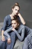 Fashion model pose on light background Stock Photography