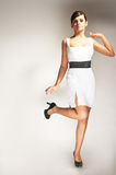 Fashion model posed in white dress Stock Image