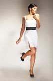 Fashion model posed in white dress Royalty Free Stock Photos
