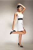 Fashion model posed in white dress Royalty Free Stock Image