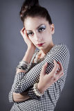 Fashion model posing. Young beautiful model posing with an elaborate makeup and hair styling stock photos