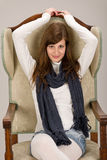 Fashion model posing on antique armchair Royalty Free Stock Image