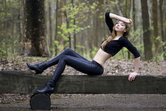 Fashion model posing on a bench Royalty Free Stock Photo