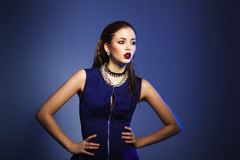 Fashion model posing in blue background Royalty Free Stock Photography