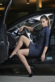 Fashion model posing in a car Royalty Free Stock Photo
