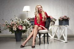 Fashion model posing in the chair Royalty Free Stock Photo