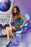 Fashion model posing in the chair Royalty Free Stock Photography