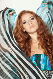 Fashion model posing in chiffon dress. Beautiful redheaded fashion model posing in chiffon dress Royalty Free Stock Photography