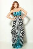 Fashion model posing in chiffon dress. Full length of a beautiful redheaded fashion model posing in long chiffon dress Stock Images
