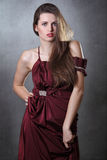 Fashion model posing with elegant red dress Royalty Free Stock Photography