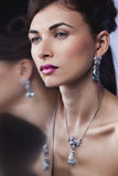 Fashion model posing in exclusive jewelry Royalty Free Stock Image