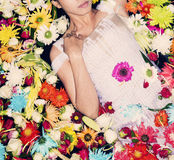 Fashion model posing with flowers stock photography