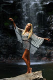 Fashion model posing in front of the waterfall Stock Photos