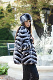 Fashion model posing in a fur coat and a fur hat Royalty Free Stock Photo