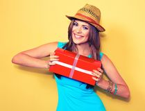 Fashion model posing with gift box. woman portrait. Long hair royalty free stock photos