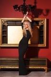 Fashion model posing in glamorous interior Stock Photography