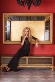Fashion model posing in glamorous interior Royalty Free Stock Image