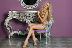 Fashion model posing in glamorous interior Stock Photography