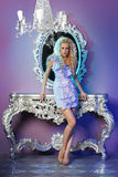 Fashion model posing in glamorous interior Stock Photos