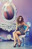 Fashion model posing in glamorous interior Royalty Free Stock Images