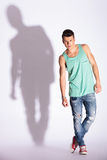 Fashion model posing on gray Royalty Free Stock Photos