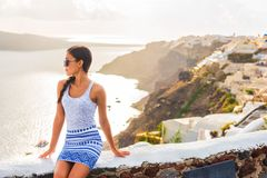 Free Fashion Model Posing In Santorini Island, Oia City, Greece, Europe Travel. Traveler Lifestyle Summer Holiday Tourist Stock Image - 155625741