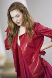 Fashion model posing in jacket and dress Stock Image