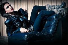 Fashion model posing in jeans royalty free stock photo