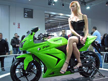 Fashion model posing on a Kawasaki Ninja 250R Royalty Free Stock Photos