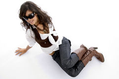 Fashion model posing lying on floor Stock Photography