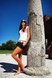 Fashion model posing near ruin. Royalty Free Stock Photography