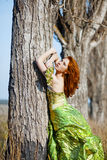 Fashion model posing in near tree Royalty Free Stock Images