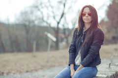 Fashion model posing outdoor wearing sunglasses Stock Photography