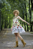 Fashion model posing outdoors. Fashion model in dress posing outdoors stock photography
