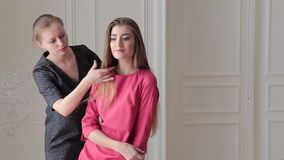 Fashion model posing in pink dress and stylist stock footage