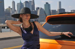 Fashion model posing pretty in front New York view. Fashion model posing pretty in front of scenic view of Manhattan, New York NY Stock Photo