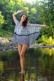 Fashion model posing pretty at the nature location Stock Photo