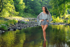 Fashion model posing pretty at the nature location Royalty Free Stock Photos
