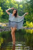 Fashion model posing pretty at the nature location. Royalty Free Stock Photography