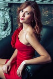 Fashion model posing in red dress. Stock Image