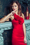 Fashion model posing in red dress. Royalty Free Stock Photography