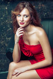 Fashion model posing in red dress. Stock Photography