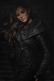 Fashion model posing in reptile leather vest Royalty Free Stock Photo