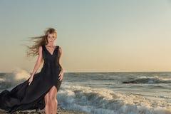 Fashion model posing at sea Stock Photo