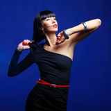 Fashion model posing in studio on a dark blue background Stock Image
