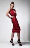 Fashion model posing in studio. Modern dress Royalty Free Stock Photography