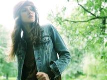 Fashion model posing in summer park Stock Image